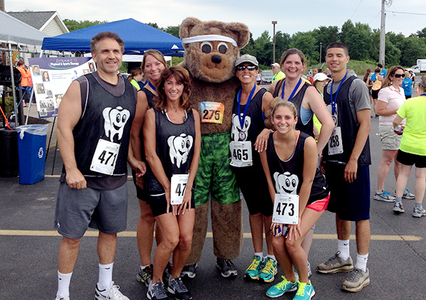 Group with Bear Mascot